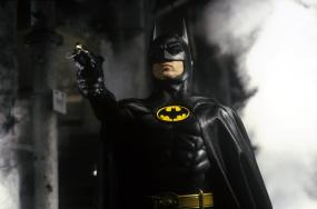 Batman (1989) + Batman Returns (1992) - Tim Burton completely redesigned the hero's look for his cinematic reboot of the character. Suddenly, Batman dressed all in black latex with fake muscles. One deficit of the suit was that Michael Keaton could not turn his head. We're sure that made crime-fighting difficult!