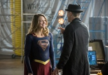 """The Flash -- """"Invasion!"""" -- Image FLA308b_0401b.jpg -- Pictured (L-R): Melissa Benoist as Kara/Supergirl and Tom Cavanagh as Harrison Wells -- Photo: Dean Buscher/The CW -- © 2016 The CW Network, LLC. All rights reserved."""
