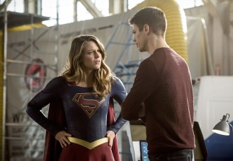 """The Flash -- """"Invasion!"""" -- Image FLA308b_0445b.jpg -- Pictured (L-R): Melissa Benoist as Kara/Supergirl and Grant Gustin as Barry Allen -- Photo: Dean Buscher/The CW -- © 2016 The CW Network, LLC. All rights reserved."""