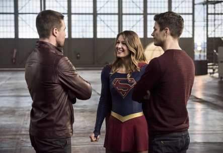 """The Flash -- """"Invasion!"""" -- Image FLA308b_0493b.jpg -- Pictured (L-R): Stephen Amell as Oliver Queen, Melissa Benoist as Kara/Supergirl and Grant Gustin as Barry Allen -- Photo: Dean Buscher/The CW -- © 2016 The CW Network, LLC. All rights reserved."""