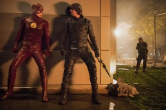 "The Flash -- ""Invasion!"" -- Image FLA308c_0466.jpg -- Pictured (L-R) Grant Gustin as The Flash, Stephen Amell as Green Arrow and David Ramsey as John Diggle -- Photo: Dean Buscher/The CW -- © 2016 The CW Network, LLC. All rights reserved"